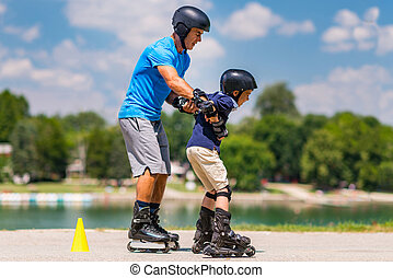 Roller skating class with senior teacher and little boy