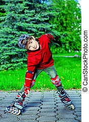 roller skating - Cool 7 year old boy rollerblades on the...