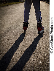 roller skating on the road, close up legs