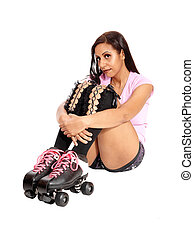 Roller skating woman sitting on the floor