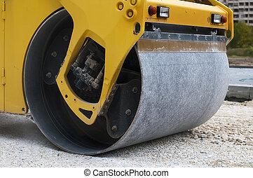 Roller tamping gravel