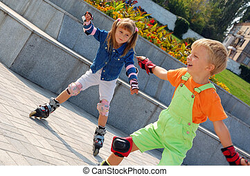Rollerblading children. - Beginners are learning inline...