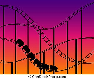 Rollercoaster silhouette on sunset sky background