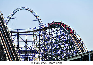 rollercoasters, en, un, parque de atracciones, con, cielo azul