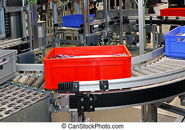 Conveyor rollers transport system for crates in factory