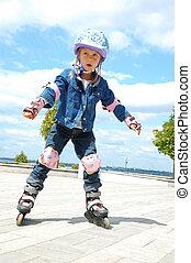 rollerskating - little girl doing her first steps in...