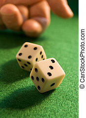 rolling dice - hand rolling dice onto a green baize