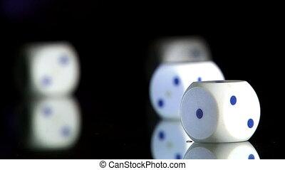 Rolling dice, closeup