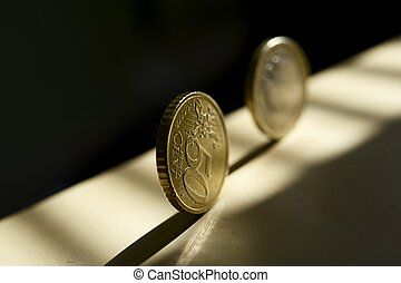 Rolling Euro Money - Rolling Euro Coins in the Sunlight....