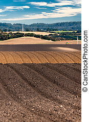 Rolling plowed fields in the Salinas Valley of California
