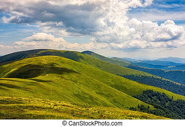 rolling hillsides of Carpathian mountain ridge. Beautiful...