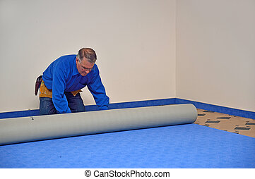 rolling out the carpet - floorlayer rolling out the new ...