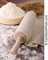 dough on rolling pin and flour