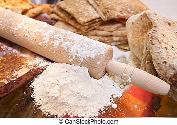 rolling pin with a flour and lavash
