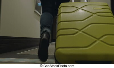 Rolling Trolley Bag in Hotel Corridor - Low-angle steadicam...