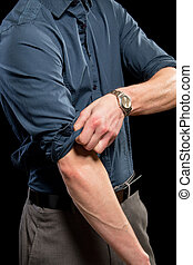 Rolling up Sleeves - Adult man rolling up his sleeves. ...