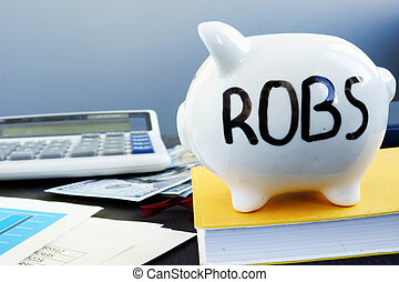 Rollover for Business Startups ROBS written on a piggy bank.