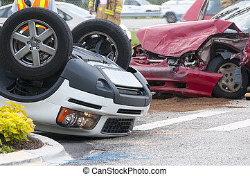 Rollover Vehicle Accident at Busy Intersection With...