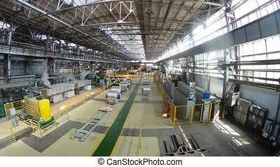 Rolls of aluminum lie in production shop of rolling mill,...