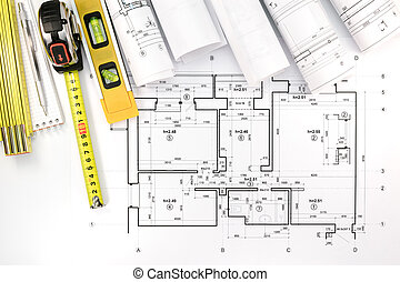 Architectural background with floor plan blueprints rolls rolls of architectural blueprints and house plan with engineering tools malvernweather Images