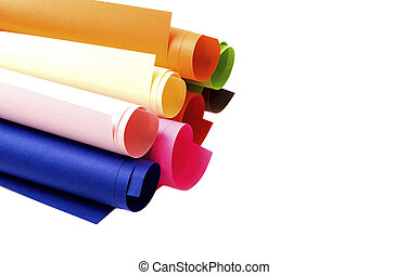 Rolls of colored paper on a white background