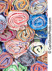 Rolls of colorful fabric.