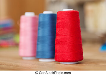 Rolls of colourful sewing thread