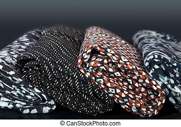 rolls of different fabrics