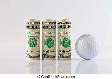 Rolls of dollar bills and golff ball