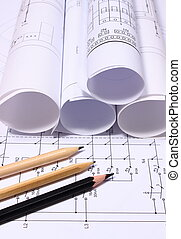 Rolls of electrical diagrams and pencils