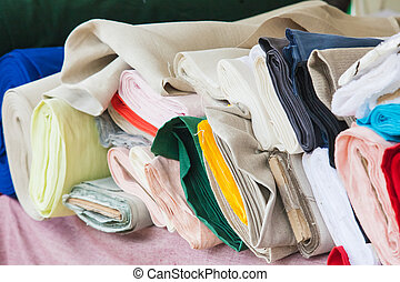 Rolls of fabric and textiles in a factory shop