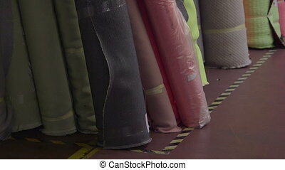 Rolls of fabric in sofas plant