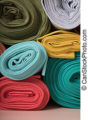 Rolls of knitted fabric in assortment