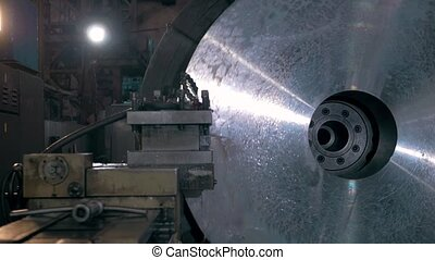 Rolls of material for production of details at factory, metal machine shop modern factory