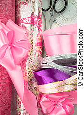 Rolls of pink wrapping paper.