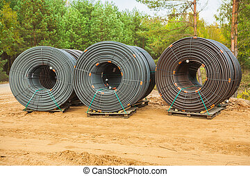 rolls of pipes in forest