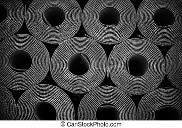rolls of roofing felt - Closeup of Rolls of new black...