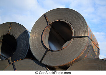 black rolls of steel sheet for transportation
