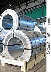 rolls of steel sheet in a warehouse