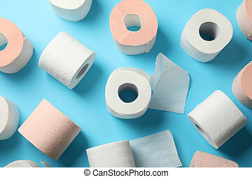 Rolls of toilet paper on blue background, top view