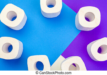 Rolls of toilet paper on color background, top view