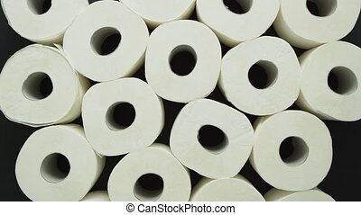 Rolls of toilet paper placed on black background - Rolls of ...