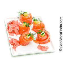rolls of trout with cucumber on a white background