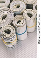 Rolls of US one hundred dollar bills