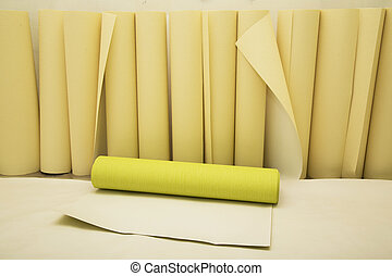 Rolls of wallpaper of two colors