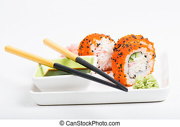Rolls on the plate with chopsticks