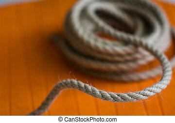 rolo, de, áspero, corda, contra, a, fundo, de, um, círculo alaranjado