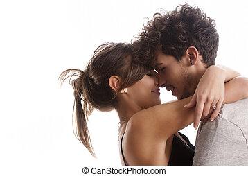 romántico, moda, pareja joven, posición, juntos, en, aislado, fondo blanco