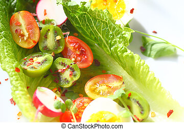 Romaine with radishes and tiny kiwi fruits
