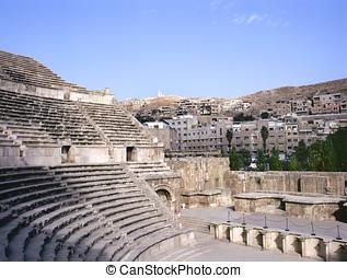 Roman amphitheater in Amman, at background the city of Amman...
